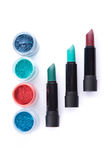 Bold lipsticks and eye shadows in matching colors Stock Photography