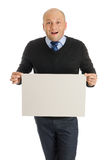 Bold man holding a blank board Royalty Free Stock Image