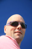 Bold man with sunglasses stock photo