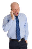 Bold man yelling at phone Stock Photo