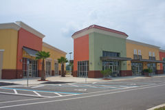 Bold pastel colored strip mall Stock Photos