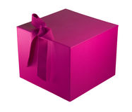 Bold pink gift box with ribbon. A deep pink gift box with an attached ribbon, sitting at an angle Royalty Free Stock Image