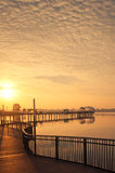 Bold Sunrise Behind A Pier Stock Images
