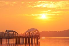 Bold Sunrise behind a pier Stock Photography