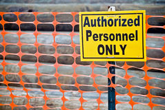 Bold yellow warning sign on fence Stock Images
