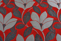 Boldly coloured floral fabric. In red with abstract flowers Royalty Free Stock Photos