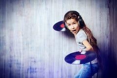 Boldness. Cute happy teen girl enjoys the music in headphones. Generation. Studio shot Stock Photography