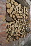 Boleslawiec, Poland - May: Firewood. A lot of firewood pieces gathered in a brick warehouse stock photo