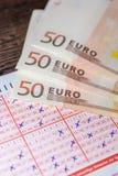 Boleto de lotería terminado como juego costoso imagenes de archivo