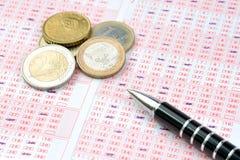 Boleto de lotería y monedas euro Imagen de archivo libre de regalías