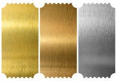 Boletos del aluminio, del bronce y del latón aislados imagen de archivo libre de regalías