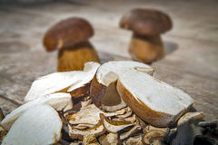 Boletus Edilus mushrooms on a wooden table  – fresh dried and Stock Photo