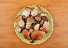 Boletus edulis mushroom on wooden board Royalty Free Stock Photos