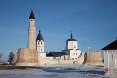 Bolgar, Tatarstan. Christianity and Islam together. Big Minaret Complex and Assumtion Church in ruins. Christianity and Islam together. Big Minaret Complex and Royalty Free Stock Photos