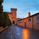 Bolgheri medieval village entrance and tower on sunset. Maremma, Stock Image