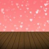 Bolhas cor-de-rosa abstratas do coração com fundo de madeira Imagem de Stock
