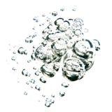 Bolhas da água sobre o fundo branco Fotografia de Stock