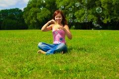 Bolhas de sabão de sopro da menina Fotos de Stock Royalty Free