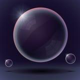 Bolhas de sabão em um fundo azul preto Foto de Stock Royalty Free