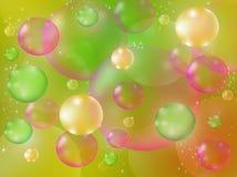 Bolhas de sabão em um fundo colorido Imagens de Stock