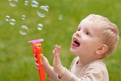 Bolhas e criança Fotos de Stock Royalty Free