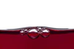 Bolhas no vinho vermelho Fotos de Stock Royalty Free