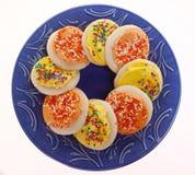 Bolinhos de açúcar geados amarelos e alaranjados Imagem de Stock Royalty Free