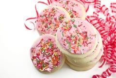Bolinhos de açúcar geados cor-de-rosa do partido Foto de Stock Royalty Free
