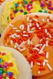 Bolinhos de açúcar amarelos e alaranjados Fotografia de Stock Royalty Free