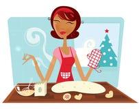 Bolinhos do cozimento da mulher do Natal na cozinha retro Imagem de Stock