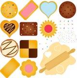 Bolinhos e biscoito com uma massa de pão Fotos de Stock