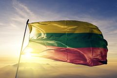 Bolivar Department of Colombia flag textile cloth fabric waving on the top sunrise mist fog. Beautiful royalty free stock photo