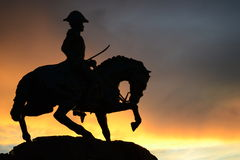 Bolivar equestrian statue. Equestrian statue of the Liberator Simon Bolivar on a orange sky sunset stock photo