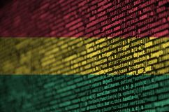 Bolivia flag is depicted on the screen with the program code. The concept of modern technology and site development.  stock photos