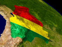 Bolivia with flag on Earth Stock Photos