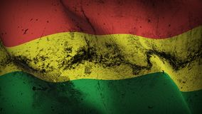 Bolivia grunge dirty flag waving on wind. Bolivian background fullscreen grease flag blowing on wind. Realistic filth fabric texture on windy day Royalty Free Stock Photography