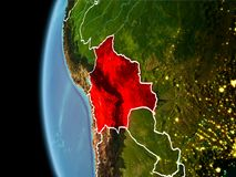 Bolivia from space in evening. Evening over Bolivia as seen from space on planet Earth with visible border lines and city lights. 3D illustration. Elements of Royalty Free Stock Image