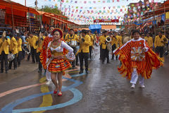 Bolivian dancer group at the Oruro Carnival in Bolivia. Group of traditional dancers in colourful costumes parading through the mining city of Oruro on the stock photos