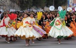 Bolivian Fiesta. Dancers performing the Morenada during a fiesta in La Paz, Bolivia Stock Images