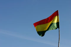 Bolivian flag. A Bolivian flag on a flagpole waving in the wind Stock Photography