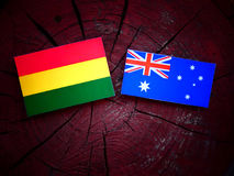 Bolivian flag with Australian flag on a tree stump isolated Royalty Free Stock Image