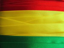 BOLIVIAN flag or banner. Made with red, yellow and green ribbons Stock Images