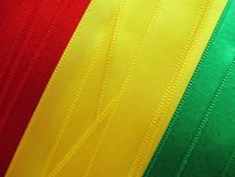 BOLIVIAN flag or banner. Made with red, yellow and green ribbons Stock Photography