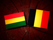 Bolivian flag with Belgian flag on a tree stump isolated Royalty Free Stock Photography