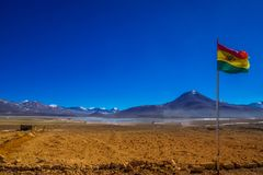 Bolivian Flag by the border to Chile in the Andes Royalty Free Stock Photos