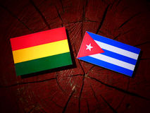 Bolivian flag with Cuban flag on a tree stump isolated Stock Image
