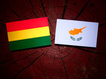 Bolivian flag with Cypriot flag on a tree stump isolated Royalty Free Stock Images