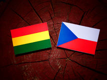 Bolivian flag with Czech flag on a tree stump  Stock Photo
