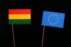 Bolivian flag with European Union EU flag isolated on black. Background Royalty Free Stock Photo