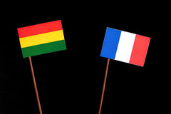 Bolivian flag with French flag isolated on black Royalty Free Stock Photos
